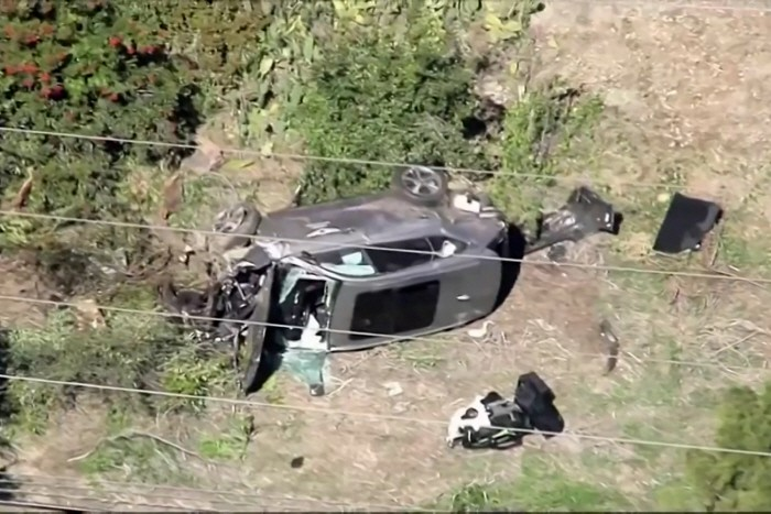 The vehicle of golfer Tiger Woods, who was rushed to hospital after suffering multiple injuries, lies on its side after being involved in a single-vehicle accident in Los Angeles, California, U.S. in a still image from video taken February 23, 2021. KNBC via REUTERS NO RESALES. NO ARCHIVES. MANDATORY CREDIT. THIS IMAGE HAS BEEN SUPPLIED BY A THIRD PARTY.